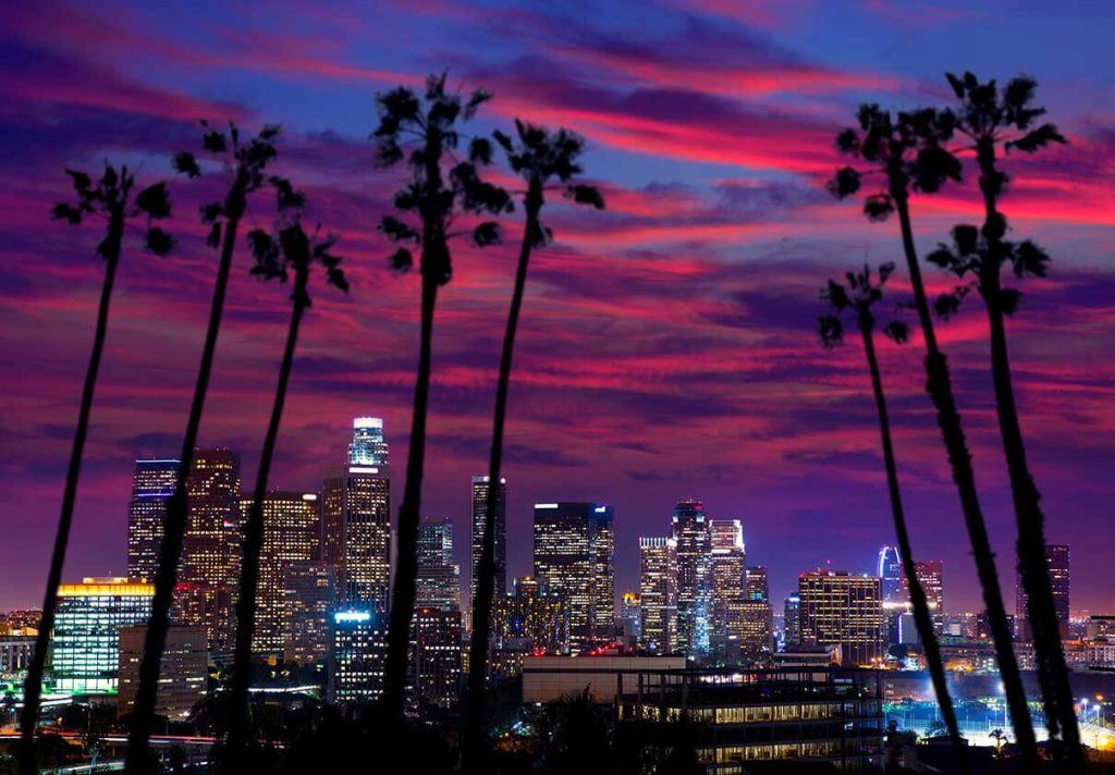 Downtown LA under vivid pink and purple sunset
