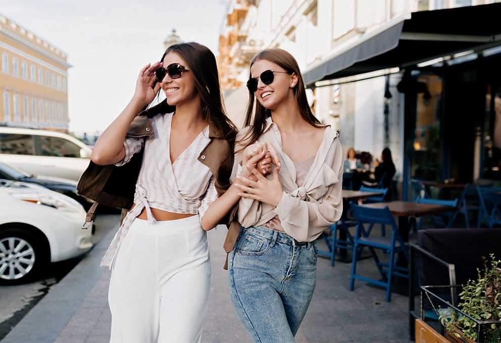 women walking wearing sunglasses