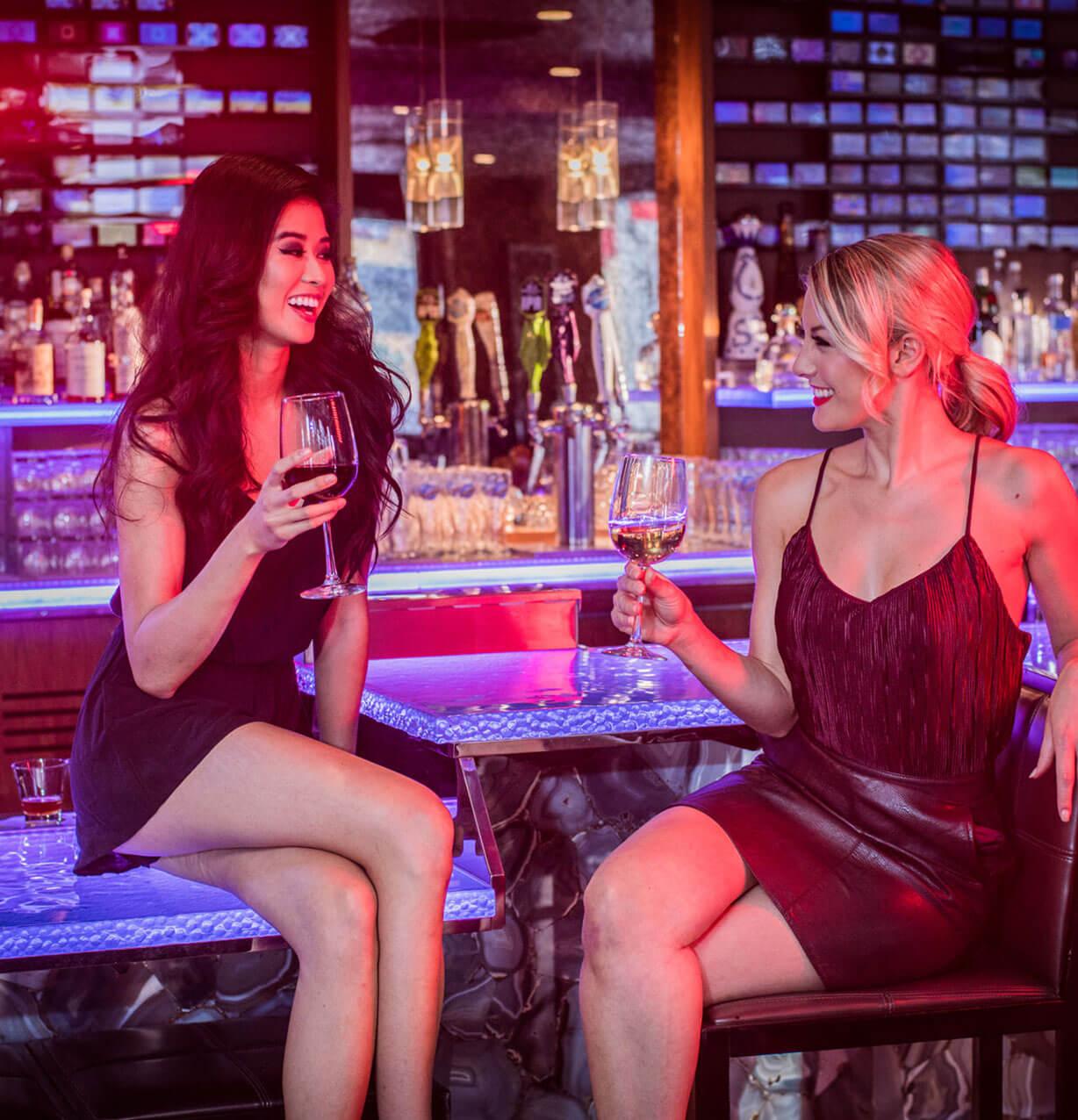Two woman enjoying wine at Nixo