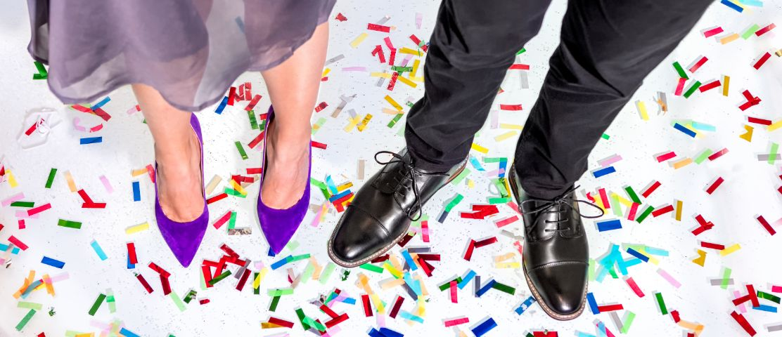 Man and woman standing in confetti