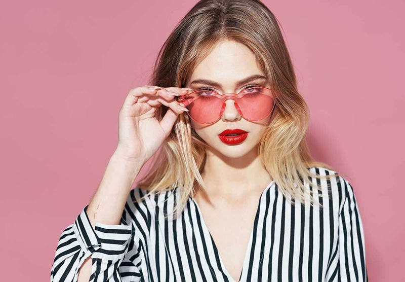 Model wearing Pink sunglasses